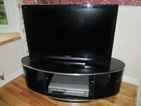 Black Glass Topped Oval Rotating TV Unit with Glass Shelf