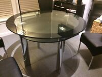 Black and clear glass round table with chrome legs