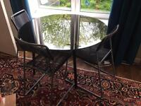 Ikea black glass top table and 4 chairs £30