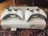 Xbox 360 with 2 controllers. White