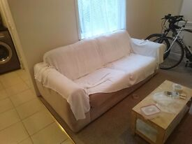 Large 4 seater sofa couch light coloured with throw included