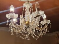 Beautiful glass and gold chandelier and two wall lights