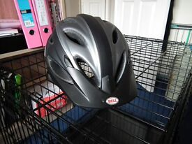 """BELL """"piston"""" cycle helmet never used. Size 54 - 61cm (adjustable)"""