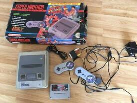 Nintendo SNES with controllers and game