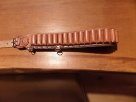 Real leather cartridge belt, unused, holds 32 shotgun cartridges.