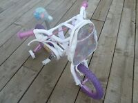 "Girls Bike Suitable for Age 4 to 6 a 14"" Avigo Rag Doll Bike with Handle BarBag (Hardly used)"