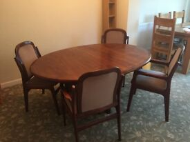 Dark wood solid extendable dining table and chairs