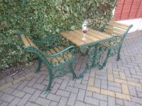 SET OF CAST IRON GARDEN OR PATIO TABLE AND PAIR OF CHAIRS IN GREEN METALLIC