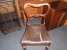 antique round back chair.