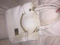 White Louis Vuitton handbag