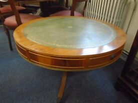 small round leather top occasional table with claw casters plus two drawers.