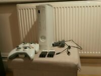 XBOX 360 WITH TWO CONTROLLERS, 60GB HARD DRIVE & TWO 256MB MEMORY CARDS.