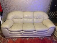white leather three seat sofa
