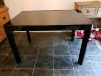 Black glass extending dining table (Will deliver locally)