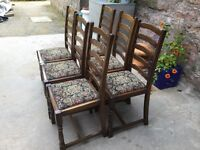 6 solid oak, ladder back, dining room chairs with tapestry base.
