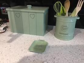 Bread bin , utensil pot and spoon rest pride of place