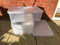 Job lot: plastic storage boxes