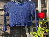 Dark blue crop top, with lace patterns, age 12-13