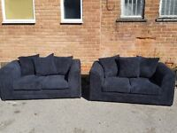 Very nice black cord sofa suite. 2 two seater sofas. 1 month old. clean and tidy. can deliver