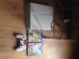 PS4 with remote and games