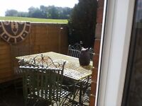 Wrought iron garden table 6 chairs