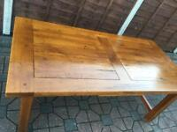 Solid oak furniture village dining table. Delivery Possible