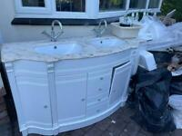 Marble topped sink unit and mirror with lights