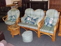 Three piece cane suite with matching table.