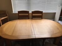 Solid Oak dining room table with six solid Oak high back chairs