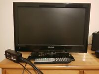 Flat 19 inch screen digital tv with built in DVD player and remote