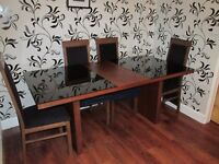 Large dinning table with 6 chairs and sideboard