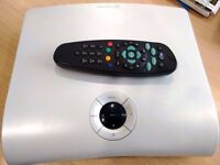 SKY BOX + REMOTE USED. POWER CABLE MISSING