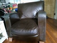 Brown Leather Armchair on Wooden Feet