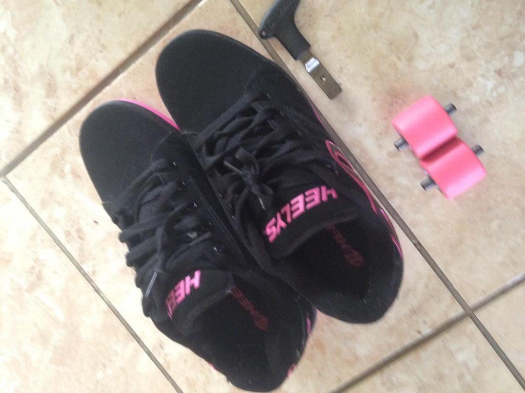 Black and pink heelys
