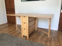 Ikea Dining table - 4/6 seater table, folds away into compact area. Includes 6 deep drawers