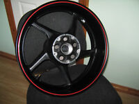 r1 yamaha 04 - 08 rear wheel small dent edge of rim but wouldnt notice when tyre on .