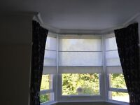 Pair of very long and very wide dark blue and bronze curtains