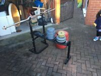 FOLD AWAY GYM BENCH AND WEIGHTS AND EXTRAS