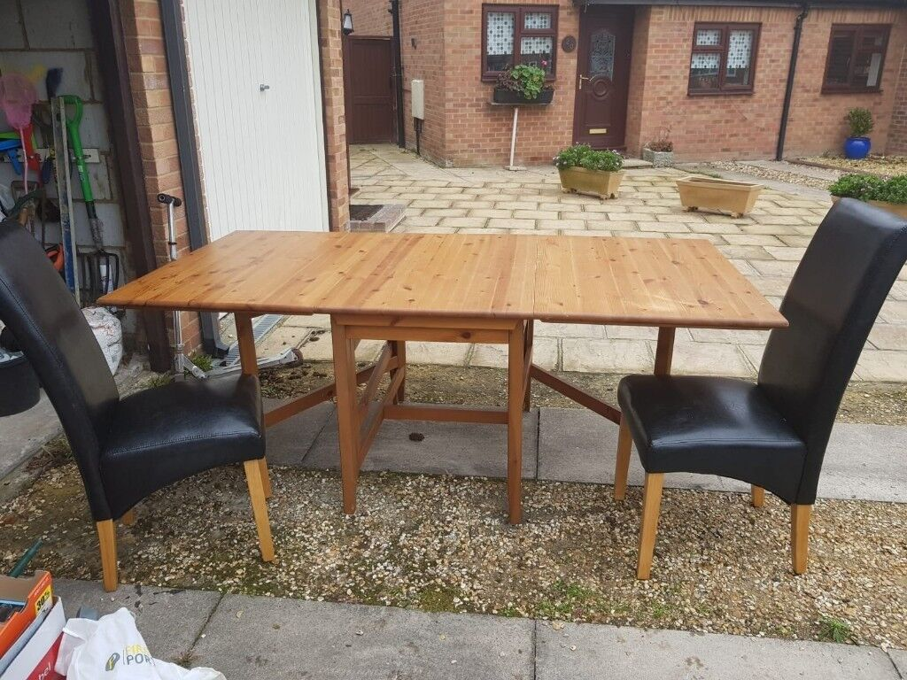 2 Leaf Wooden Dining Table Seats 6 Folds Down For Easy Storage