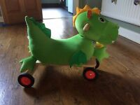 Ride on Dragon (Wonderworld). As new wooden/plush, steerable ride-on with squeaker and crinkly ears