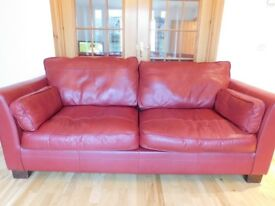 Red leather sofa and armchair