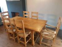 Solid oak dinning table and 6 chairs