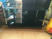 TV Stand, sturdy black glass with silver legs