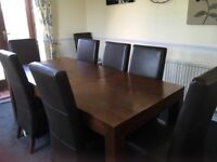 Next extendable dining table and chaires comes complete with 8 high back chaires