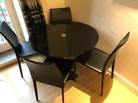 Dining set- glass table, and 4 chairs