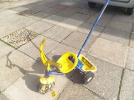 Child's blue/yellow 3 wheeler bicycle