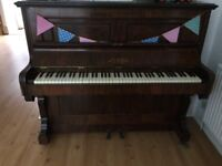 untuned piano. Free to anyone who wants to take it away