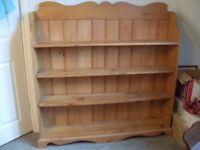 "Pine bookshelf 50""wide and 50"" high with shelves 8""deep two are removable and two are fixed."