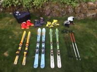 Good quality kids skis + boots, poles and helmets