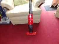 small red bagless hoover ideal for caravan or stairs working